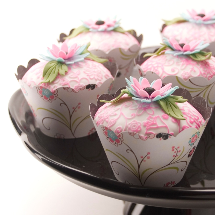 Pink, green and blue floral cupcakes